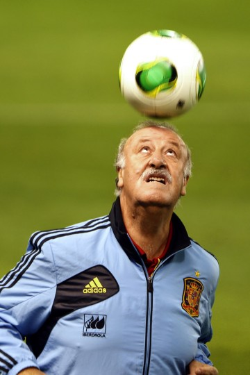 Spain's coach Vicente del Bosque heads the ball during a training session at the Carlos del Monte stadium in Albacete on the eve of their World Cup 2014 qualifying football match vs. Georgia. (JOSE JORDAN / AFP/Getty Images)