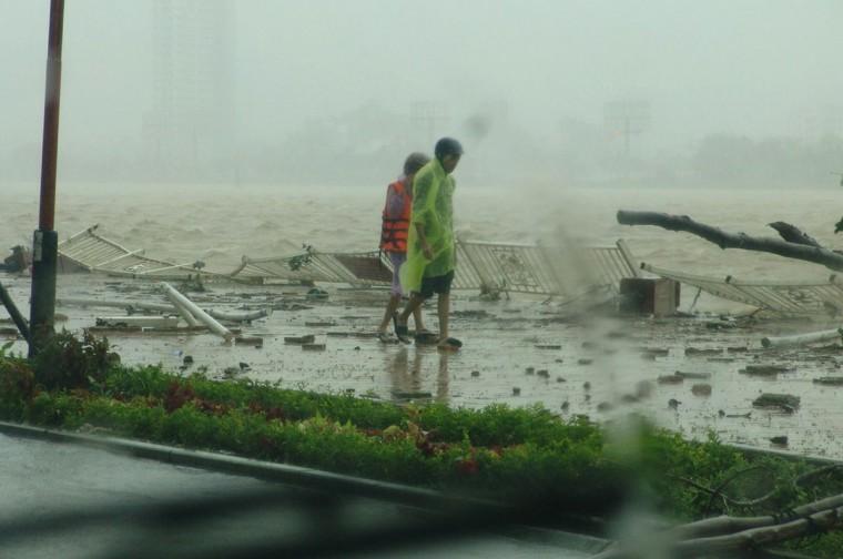 People walk along the Han river as Typhoon Nari hit the central coastal city of Da Nang. (AFP/Getty Images)