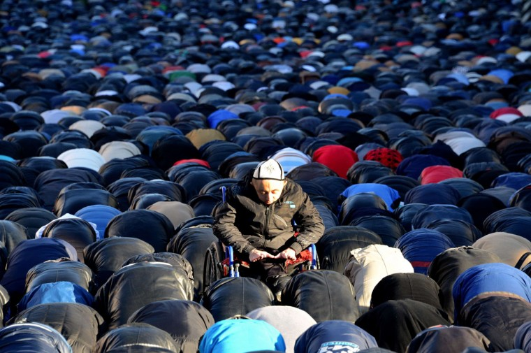 Russian Muslims pray outside Moscow's central mosque during celebrations of Eid al-Adha. (KIRILL KUDRYAVTSEV / AFP/Getty Images)