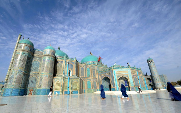 Afghan women go to the main mosque to offer Eid-al-Adha prayers in the main mosque in the city of Mazar-i-Sharif in Balkh province. (FARSHAD USYAN / AFP/Getty Images)