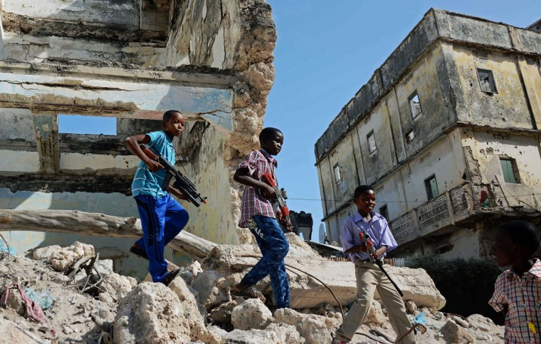 Somali children play with toy guns during celebrations for Eid al-Adha in Mogadishu. (Mohamed Abdiwahab / AFP/Getty Images)