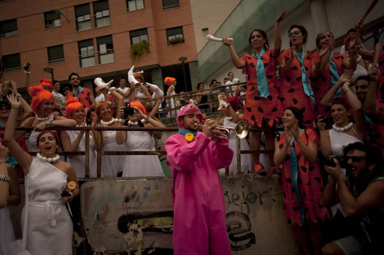 """Medical students dressed up as characters of the cartoon """"the Flintstones"""" take part in a hazing at the Faculty of Medicine of the University of Granada, in Granada on October 17, 2013. (Jorge Guerrero/AFP)"""