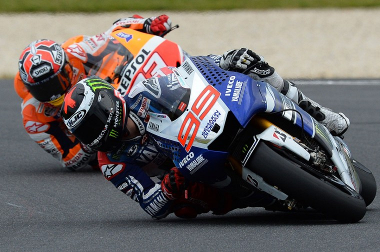Yamaha Factory Racing's Jorge Lorenzo of Spain takes a corner ahead of Repsol Honda rider Marc Marquez of Spain during the Australian MotoGP Grand Prix at Phillip Island. (SAEED KHAN / AFP/Getty Images)