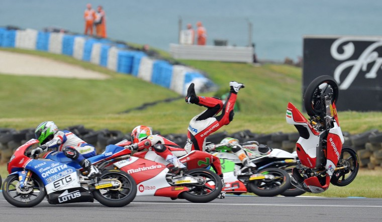 Mahindra Racing rider Miguel Oliveira of Portugal crashes out during the Moto3 race at the Australian Grand Prix at Phillip Island. (RUSSELL COLVIN / AFP/Getty Images)