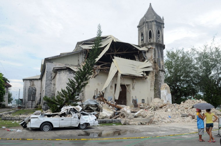 People look at the damaged historic Dauis Church in Dauis town on the central Philippine island of Bohol following a 7.1 magnitude quake that hit the area on October 15. (JAY DIRECTO / AFP/Getty Images)