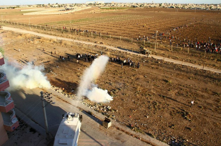 Turkish riot police use a water cannon to disperse Turkish-Kurd protesters demonstrating on the Turkish side as Syrian Kurds gather on the other side of the border in Mardin' Nusaybin district. (MEHMET ENGIN / AFP/Getty Images)