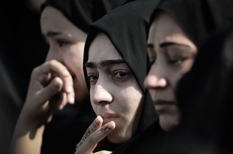 Bahraini women mourn during the funeral of Hussain Mahdi Habib in the village of Sitra, south of Manama. Habib, 20, a political prisoner who escaped from prison on May 19, was found the day before after he was allegedly shot dead near Al Malkiyah coastal village. (MOHAMMED AL-SHAIKH / AFP/Getty Images)