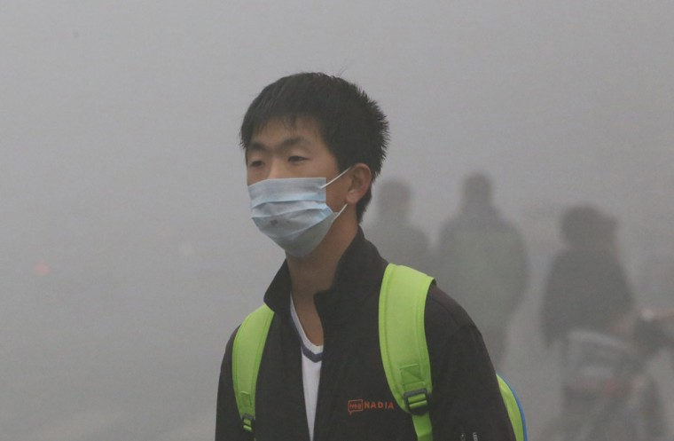 A man wearing a mask walks in heavy smog in Harbin, located in northeast China's Heilongjiang province. (AFP/Getty photo)