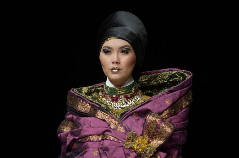 An Indonesian model displays a Muslim-themed outfit made from Riau's woven fabric, one of Indonesia's traditional woven fabrics from Riau province, designed by Indonesian designer Deden Siswanto, at Jakarta Fashion Week. (ADEK BERRY / AFP/Getty Images)