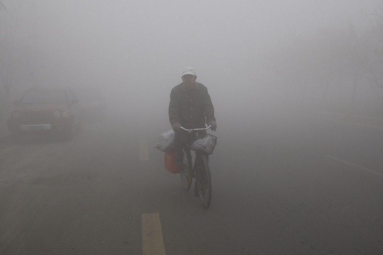 A man cycles in the smog in Harbin. (AFP/Getty Images)