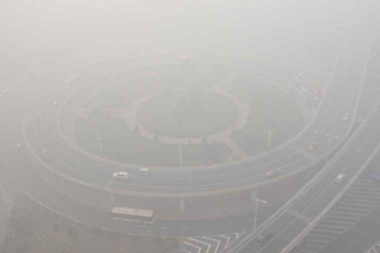 Streets and cars are seen under heavy smog in Harbin. (AFP/Getty Images)