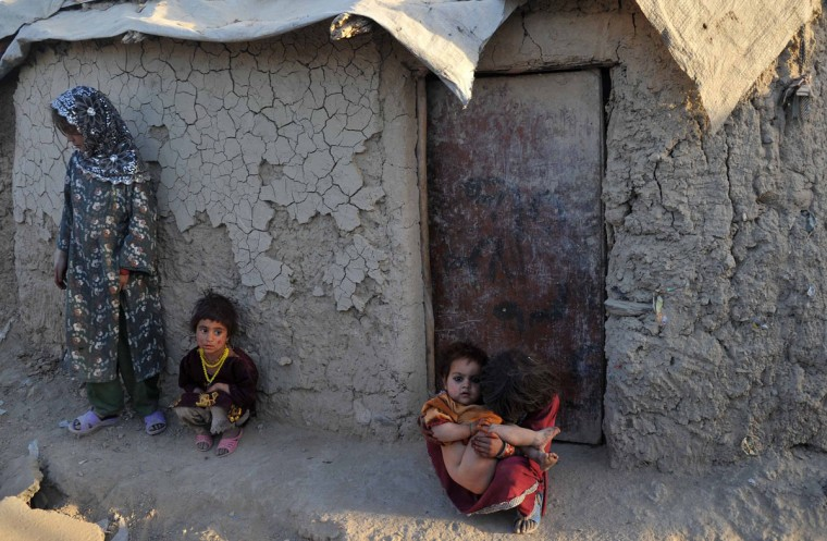 Afghan internally displaced children look on at their temporary house on the outskirts of Kabul. (Noorullah Shirzada / AFP/Getty Images)