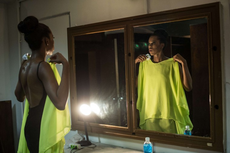 A candidate prepares in the dressing room during the Miss T Brasil 2013 transgender beauty pageant in Rio de Janeiro. (YASUYOSHI CHIBA / AFP/Getty Images)