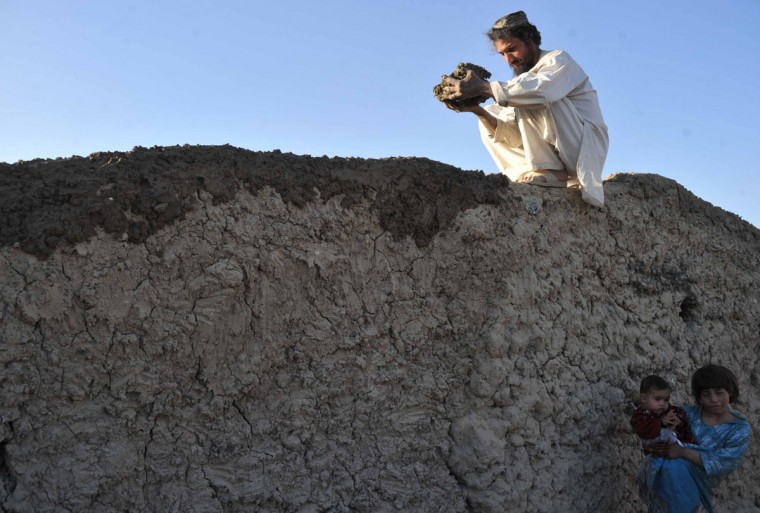 An Afghan mason builds a wall on a temporary house on the outskirts of Kabul. (Noorullah Shirzada / AFP/Getty Images)