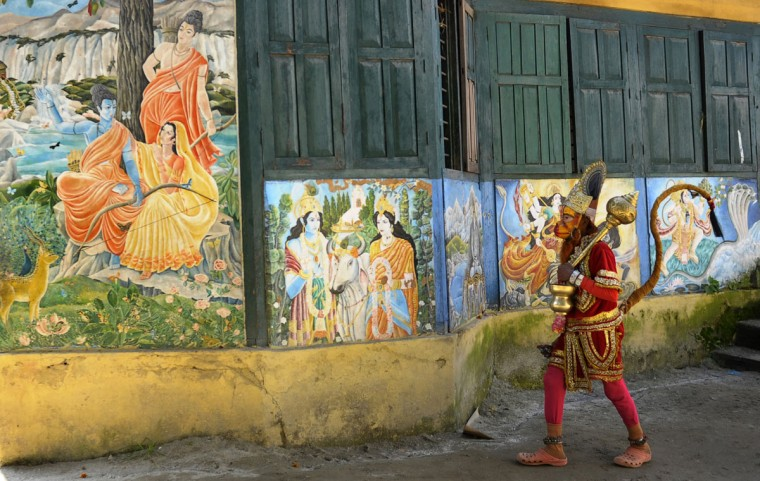 A Hindu sadhu - holy man - dressed as Hanuman, the monkey god, walks at The Pashupatinath Temple area in Kathmandu. (PRAKASH MATHEMA / AFP/Getty Images)