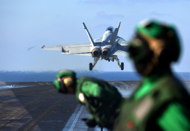 An F/A-18E Super Hornet takes-off from the flight deck of the US navy's supercarrier USS Nimitz (CVN 68) in the Mediterranean Sea on October 24, 2013. The US aircraft carrier is on standby in case of a flare up in Syria and left the Red Sea for a brief stint in the Mediterranean Sea. (Alberto Pizzoli/AFP)