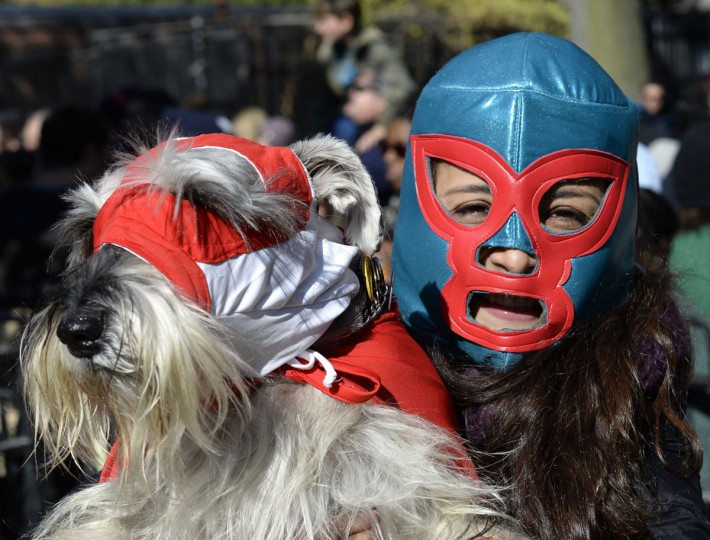 A woman and her dog dressed as wrestlers participate in the 23rd Annual Tompkins Square Halloween Dog Parade on October 26, 2013 in New York City. Thousands of spectators gather in Tompkins Square Park to watch hundreds of masquerading dogs in the countrys largest Halloween Dog Parade. (Timothy Clary/AFP/Getty Images)
