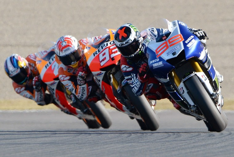 Yamaha Factory Racing rider Jorge Lorenzo of Spain leads Repsol Honda team rider Marc Marquez of Spain (center) and Repsol Honda team rider Dani Pedrosa of Spain (left) before going on to win the MotoGP race of the Japanese Grand Prix at the Twin Ring Motegi circuit in Motegi. (TOSHIFUMI KITAMURA / AFP/Getty Images)