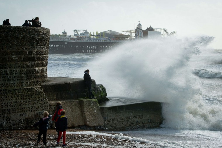 Large waves break against barriers on the seafront in Brighton, southern England on October 27, 2013 as a predicted storm starts to build. Britain was braced on October 27 for its worst storm in a decade, with heavy rain and winds of more than 80 miles an hour set to batter the south of the country. (Leon Neal/AFP/Getty Images)