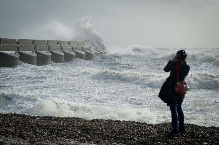 Large waves crash against the walls of Brighton Marina, southern England on October 27, 2013 as high winds pick up ahead of an expected storm. Britain was braced on October 27 for its worst storm in a decade, with heavy rain and winds of more than 80 miles an hour set to batter the south of the country. (Leon Neal/AFP/Getty Images)