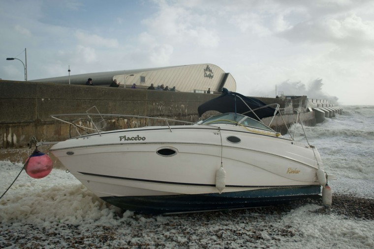A boat is moored on the beach as large waves crash against the walls of Brighton Marina, in Brighton, southern England on October 27, 2013 as high winds pick up ahead of an expected storm. Britain was braced on October 27 for its worst storm in a decade, with heavy rain and winds of more than 80 miles an hour set to batter the south of the country. (Leon Neal/AFP/Getty Images)