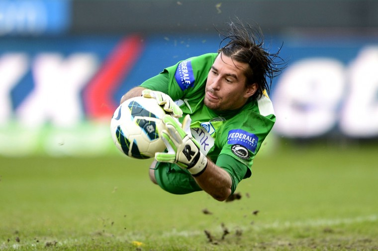 Belgian football club Genk's goalkeeper Laszlo Koteles catches a ball during the Jupiler Pro League match between Club Brugge KV and KRC Genk, in Brugge. (YORICK JANSENS / AFP/Getty Images)