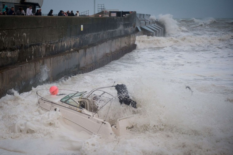 A boat is dragged from its mooring on the beach and destroyed by large waves near Brighton Marina, in southern England on October 27, 2013 ahead of a predicted storm. Britain was braced on October 27 for its worst storm in a decade, with heavy rain and winds of more than 80 miles an hour set to batter the south of the country. (Leon Neal/AFP/Getty Images)