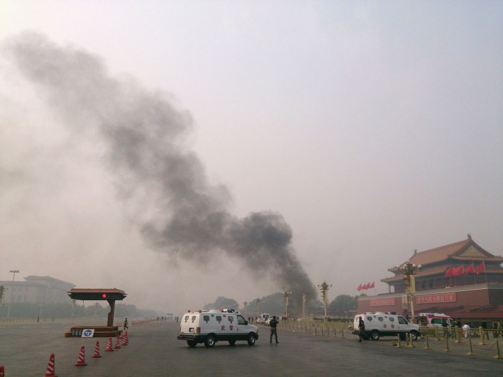 Police cars block off the roads leading into Tiananmen Square as smoke rises into the air after a vehicle crashed in front of Tiananmen Gate in Beijing. (AFP/Getty Images)