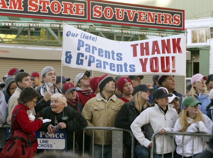 Faithful Red Sox fans gather around Fenway Park in Boston early Thursday morning Oct. 28, 2004 waiting for their triumphant team to return home. The Boston Red Sox swept the St Louis Cardinals in four games to win their first World Series since 1918. (Bizuayehu Tesfaye/AP Photo)