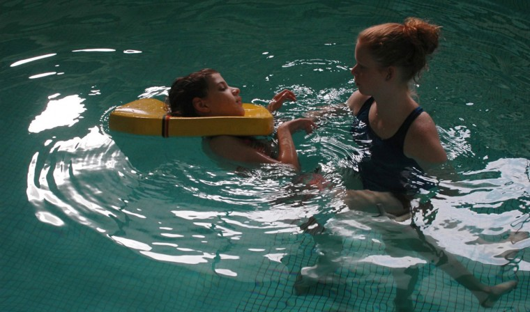 In October 2004 Tara Orner, an Aquatics instructor at Ruth Parker Eason School, works with 13-year-old Rita Ghrist. The school specializes in working with children with disabilities. (Barbara Haddock Taylor/Baltimore Sun)