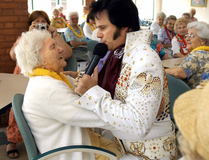 In July 2004 at the Westminster Senior Activity Center. Elvis impersonator Tom Connelly visits the center's Hawaiin Luau party. Here, he sings to Beulah Belt, 94, the oldest guest in the crowd. (Barbara Haddock Taylor/Baltimore Sun)