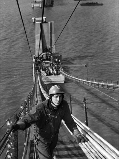 The wind is high but the view is fantastic about the Chesapeake as Fil Horton inspects cable being pulled from reels to a distant pier of the Bay Bridge in April 1952. (Hans Marx/Baltimore Sun)