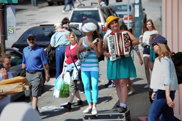 Left to right, Molly Shannon and Luz Gaxiola are Duo Finelli. They perform on a street corner near Seattle's Pike Place Market. (Kim Hairston/Baltimore Sun)