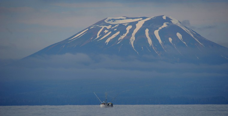 A salmon fishing boat works the waters near Mount Edgecumbe, a dormant volcano near Sitka, Alaska, Alaskan cruise. (Kim Hairston/Baltimore Sun)
