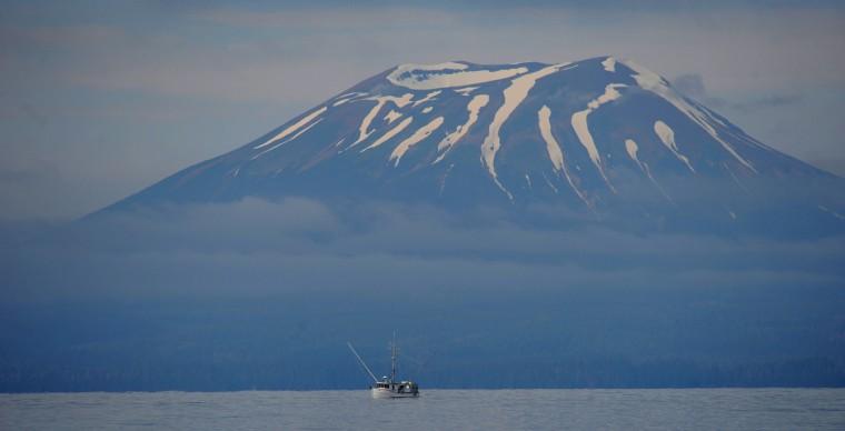 A salmon fishing boat works the waters near Mount Edgecumbe, a dormant volcano near Sitka, Alaska, Alaskan cruise. (Kim Hairston/Baltimore Sun)