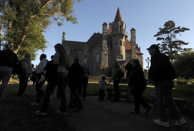 Tourists walk to the entrance to Craigdarroch Castle, a Victorian mansion built in the late 1880s for Robert Dunsmuir. The coal magnate built Craigdarroch on a hill overlooking Victoria. (Kim Hairston/Baltimore Sun)