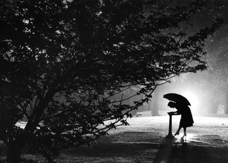 "With this April 1955 photo of a woman in a Baltimore park titled ""A Drink in the Rain,"" Stacks won Best in the Pictorial Class in the Baltimore Press Photographers' Association contest for that year. (Richard Stacks/Baltimore Sun)"