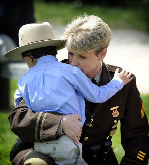 In May 2013 Maryland State Police Sergeant Julianne Pritchard hugs Hector Ayala Junior at the 28th annual observance of Fallen Heroes Day, held at Dulaney Valley Memorial Gardens. Hector's father, Hector Ayala,Sr., was a Montgomery county police officer who died in 2010. (Barbara Haddock Taylor/Baltimore Sun)