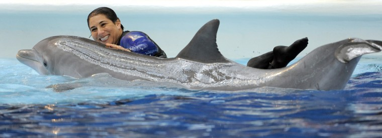 Allison Ginsburg is the Manager of Marine Mammal Training at the aquarium. (Lloyd Fox/Baltimore Sun)