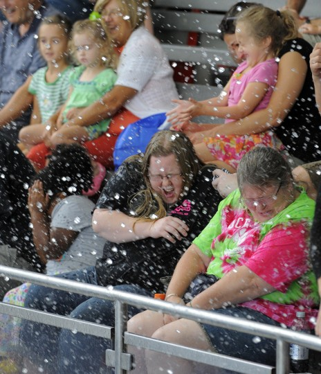 Visitors get splashed by the dolphins while sitting in the Splash Zone. (Lloyd Fox/Baltimore Sun)
