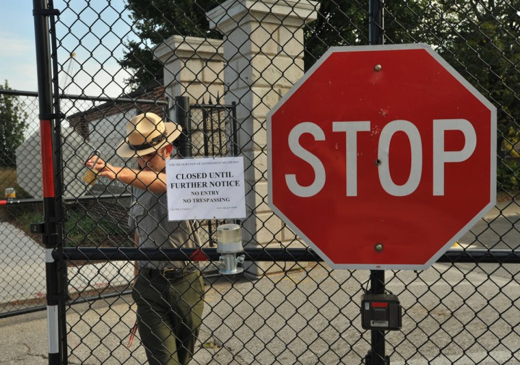 Park Ranger Tyler Mink, who has worked at Fort McHenry for 5 years, and volunteered at the Fort for 5 years before being hired, locks the gate after leaving Tuesday morning. Fort McHenry was closed today due to the government shutdown. (Amy Davis/Baltimore Sun)