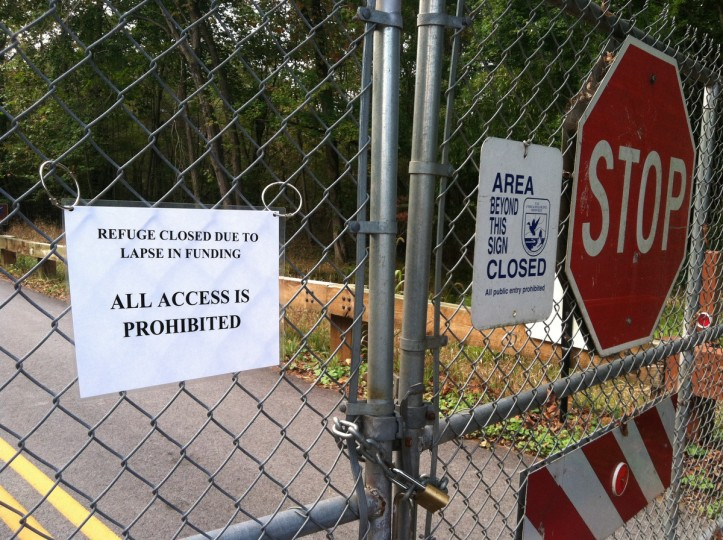 "The gates of the North Tract of the Patuxent Research Refuge near Odenton are locked and closed on Tuesday morning. A sign reads, ""Refuge closed due to lapse in funding."" The Patuxent Research Refuge includes 13,000 acres of land in Prince George's and Anne Arundel counties. It has 250,000 visitors per year, according to Jeffries Bolden, a park ranger who was among the government workers furloughed due to the federal government shut down. (Pamela Wood/Baltimore Sun)"