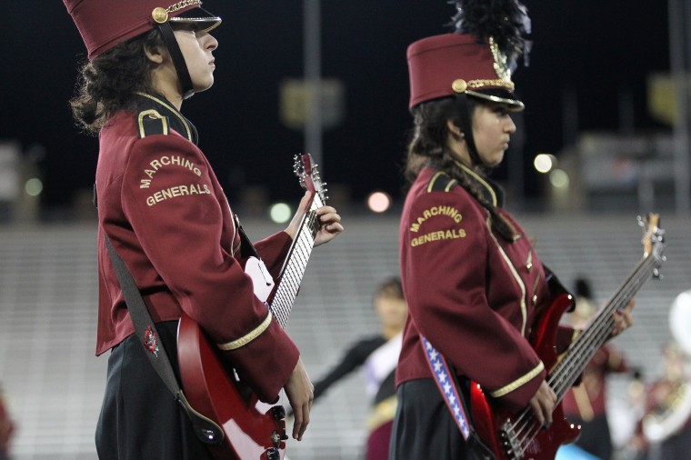 Towson High School Marching Band's Rose Alon, left, 15, and Synneove Schmitz, right, 15, play the guitar. (Jen Rynda/BSMG)