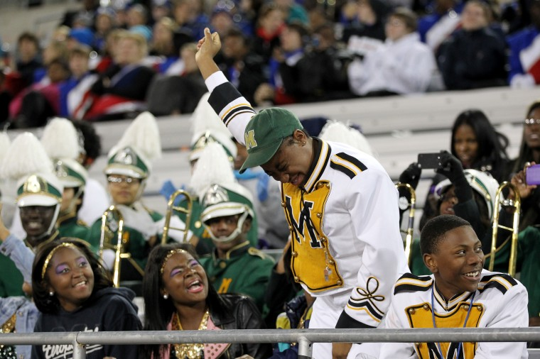 The Milford Mill Marching Band dances during Morgan State University Magnificent Marching Machine's special exhibition performance. (Jen Rynda/BSMG)