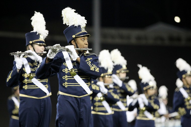 Perry Hall High School Marching Band's Piper Bowie, 17, plays the flute. (Jen Rynda/BSMG)