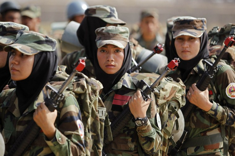 Afghan National Army (ANA) female officers take part in a training exercise at the Kabul Military Training Center (KMTC) in Kabul, October 8, 2013. (Omar Sobhani/Reuters)