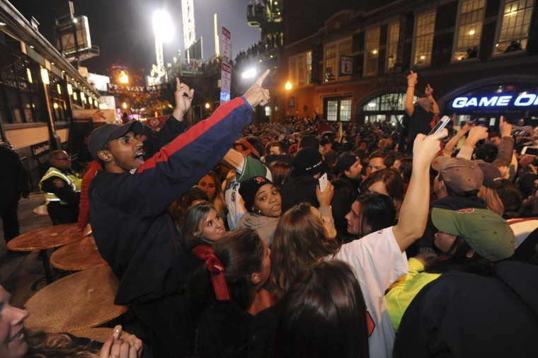 Boston Red Sox fans react to their team winning the World Series after beating St. Louis Cardinals, at Landsdown Street near Fenway Park. (Tory Germann/Reuters)