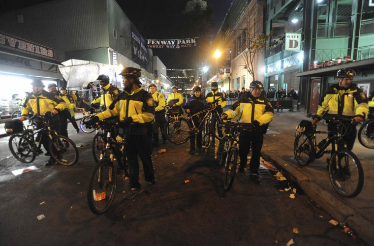 Police with their bicycles move crowds away from Fenway Park after the Boston Red Sox beat the St. Louis Cardinals and win Game 6 of the World Series in Boston. (Tory Germann/Reuters)