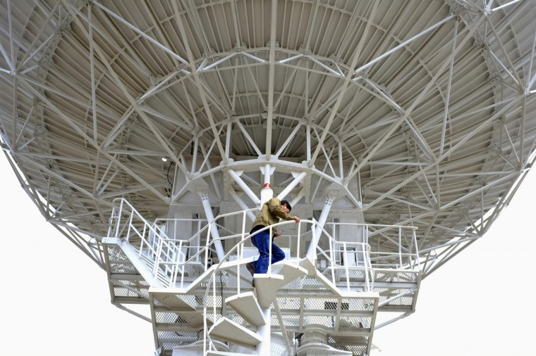 Bolivian engineer Ivas Zambrana walks up a parabolic antenna at the Bolivian space agency control plant in Amachuma on the outskirts of La Paz, October 24, 2013. China Great Wall Industry Corporation will launch Bolivia's first communications satellite, Tupac Katari, next December, reported local media. (David Mercado/Reuters)