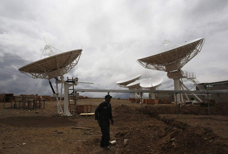 A worker is seen in the Bolivian space agency control plant in Amachuma, on the outskirts of La Paz, October 24, 2013. China Great Wall Industry Corporation will launch Bolivia's first communications satellite, Tupac Katari, next December, reported local media. (David Mercado /Reuters)